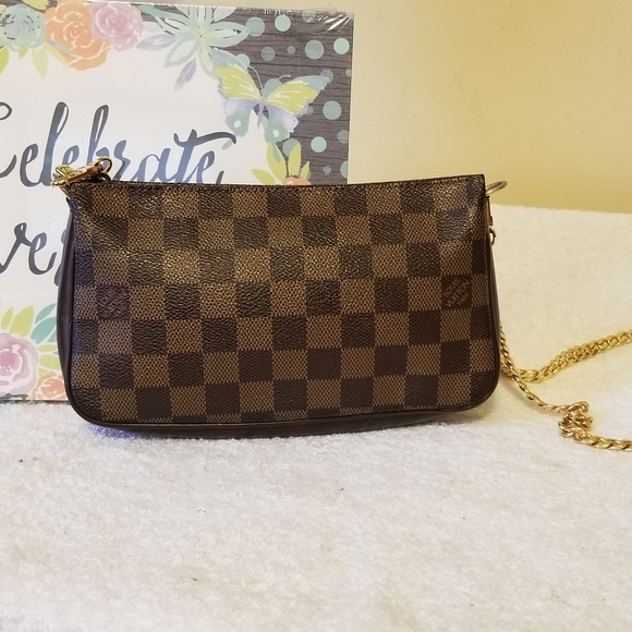 Louis Vuitton Handbags - LV navona pochette authentic